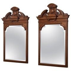 Pair of 19th Century Irish Neoclassical Carved Walnut Mirrors
