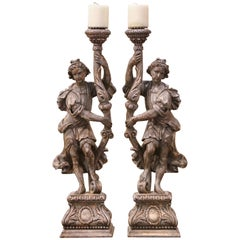 Pair of 19th Century Italian Carved and Grey Painted Figure Candlesticks