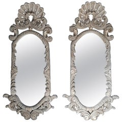 Pair of 19th Century Italian Carved Wood Mirrors with a Light Green Gray Patina