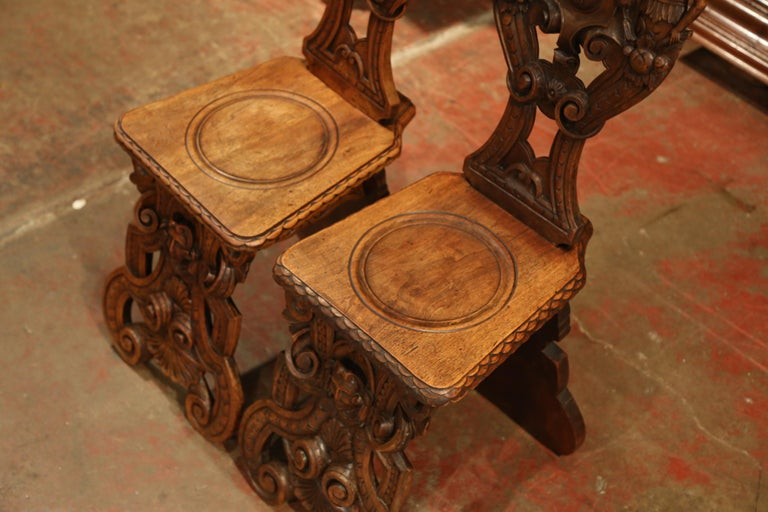 Pair of 19th Century Italian Renaissance Carved Walnut Sgabello Hall Chairs For Sale 5