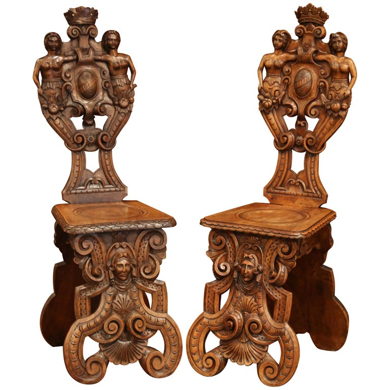 Pair of 19th Century Italian Renaissance Carved Walnut Sgabello Hall Chairs For Sale
