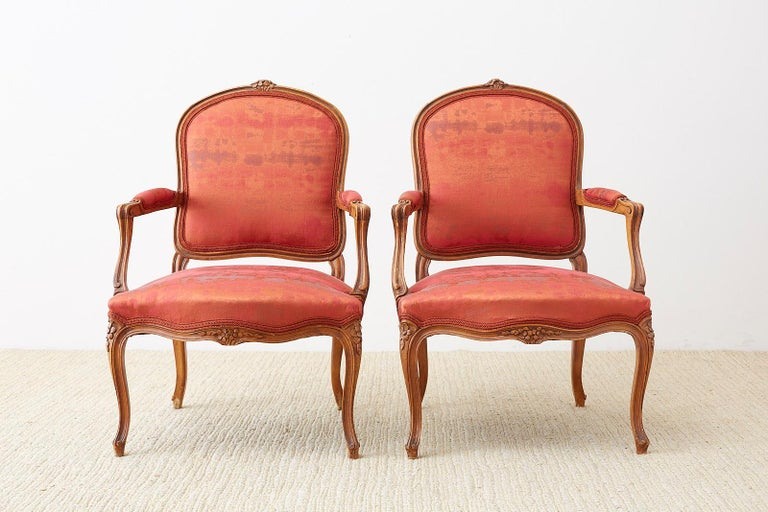 French Pair of 19th Century Louis XV Carved Walnut Armchairs For Sale
