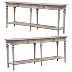 Pair of 19th Century Louis XVI Carved Painted Consoles with Faux Marble Top