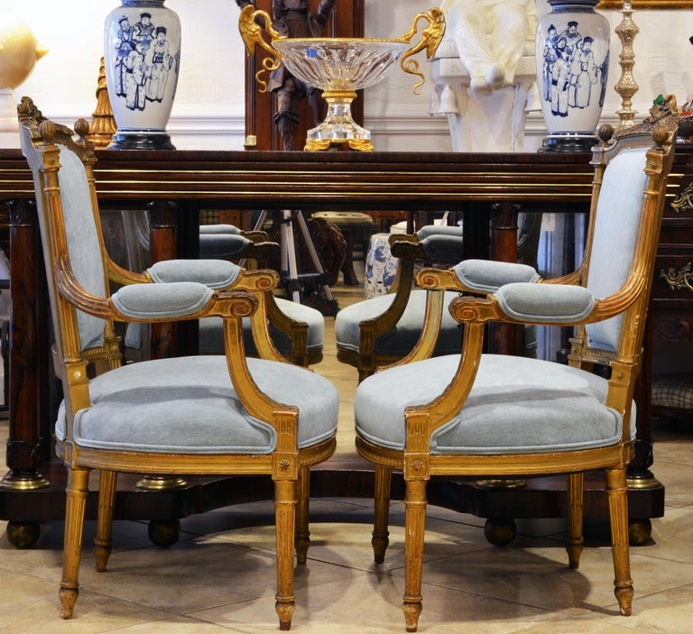 French Pair of 19th Century Louis XVI Style Carved Giltwood Upholstered Open Armchairs For Sale