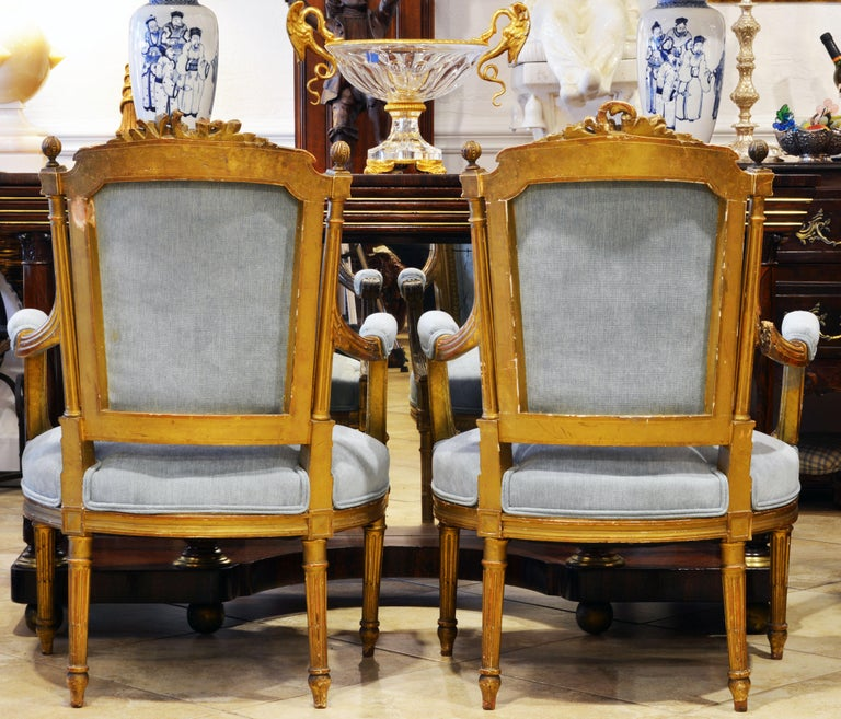 Hand-Carved Pair of 19th Century Louis XVI Style Carved Giltwood Upholstered Open Armchairs For Sale
