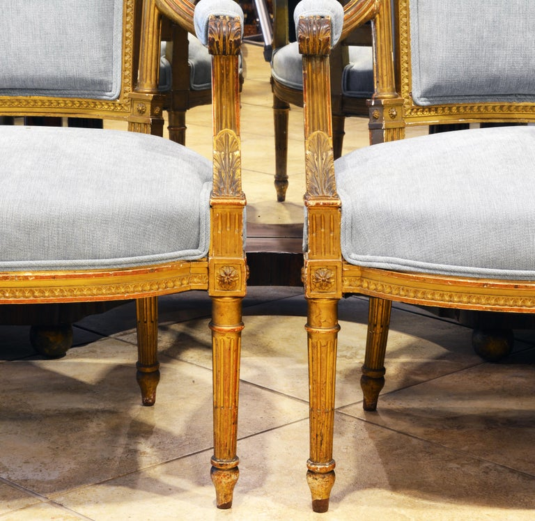 Pair of 19th Century Louis XVI Style Carved Giltwood Upholstered Open Armchairs In Good Condition For Sale In Ft. Lauderdale, FL