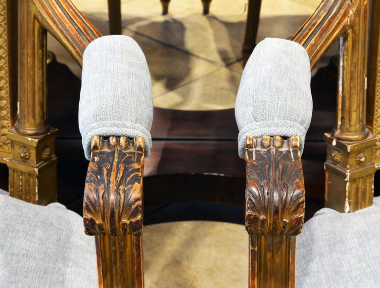 Fabric Pair of 19th Century Louis XVI Style Carved Giltwood Upholstered Open Armchairs For Sale