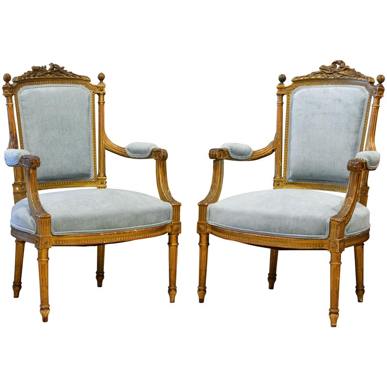 Pair of 19th Century Louis XVI Style Carved Giltwood Upholstered Open Armchairs For Sale