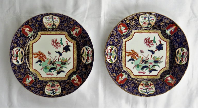 These are a beautiful pair of Mason's ironstone large Dinner Plates made during the mid-19th century, when Mason's was owned by Ashworth Brothers, circa 1870.  The plates have a very detailed Chinoiserie pattern depicting a central octagonal panel,