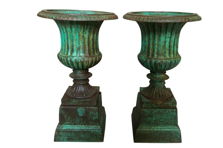 A wonderful pair of 19th century Medici style urns from Galicia, Spain. Wonderfully cast in iron with the wonderful painted finish. Perfect for any interior or garden.