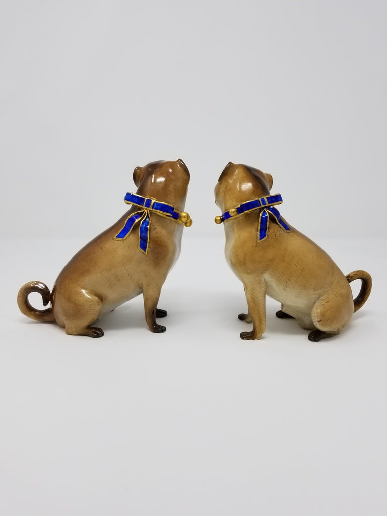 A beautiful pair of 19th century Meissen Porcelain figures of pug dogs with gilt bell collars. Each pug is exceptionally hand-carved and hand-painted to seem as realistic as possible. With a beautiful multi-toned brown overcoat fur and contrasting