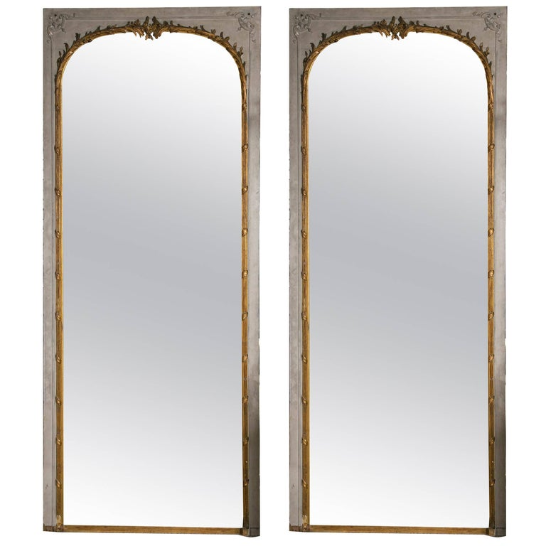 Pair of 19th Century Monumental Parcel Gilt and Paint Decorated Trumeau Mirrors