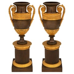 Pair of 19th Century Neoclassical Style Patinated Bronze and Ormolu Urns
