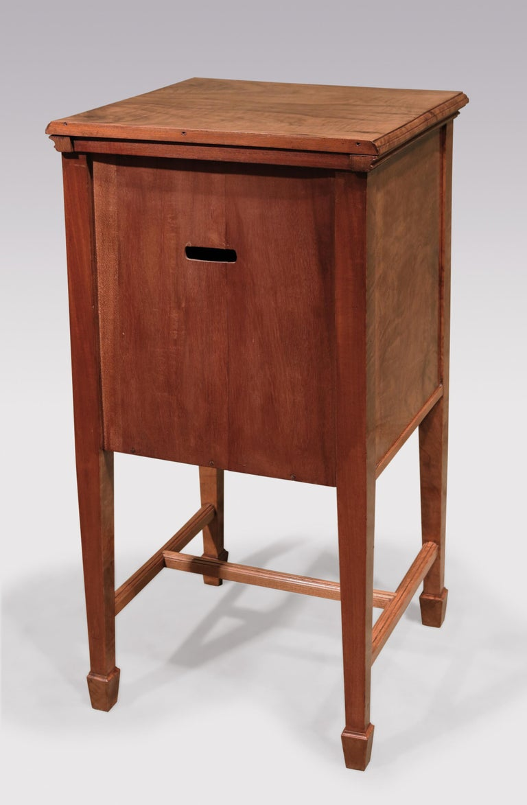 A pair of late 19th century continental olivewood bedside cabinets, tulipwood and ebony inlaid throughout, having frieze drawers above cupboard doors supported on square tapering legs with stretches and spade toes.