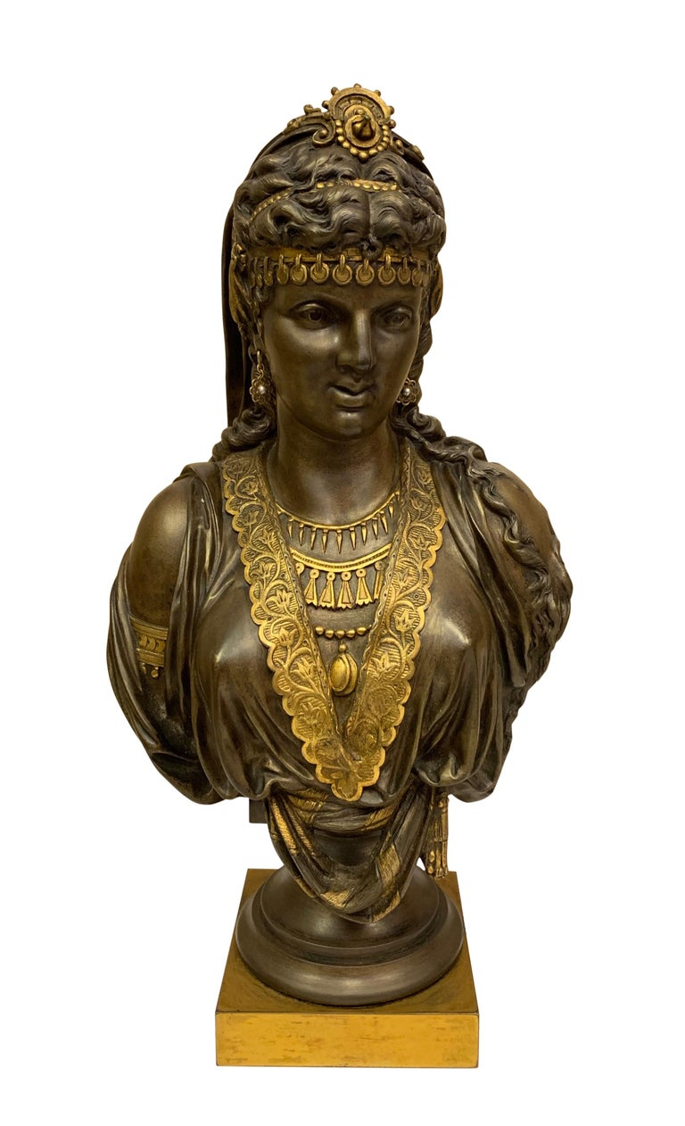 A pair of superb quality 19th century gilt and patinated bronze orientalist busts. Each young lady dressed in traditional middle eastern attire wearing beaded necklaces and earrings,  circa 1860  Dimensions Height 14