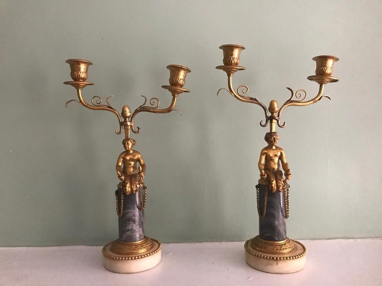 Beautiful pair of 19th century ormolu and marble candelabra with lovely figurines of mermaid/merman with human torso and fishtail in ormolu and double candelabra mounted on a marble base. 