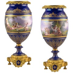 Pair of 19th Century Ormolu-Mounted Sèvres Style Cobalt-Blue Ground Vases