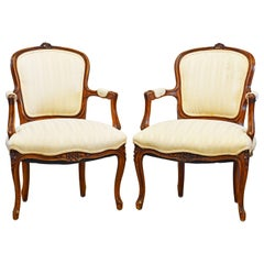 Pair of 19th Century Petite French Louis XV Style Carved Upholstered Armchairs