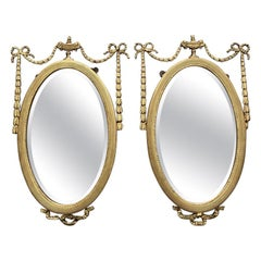Pair of 19th Century Regency Oval Gilt Mirrors with Bevelled Mirror Glass