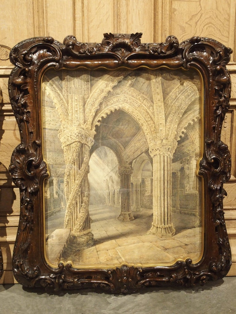 This impressive pair of large watercolor paintings are surrounded by elaborate hand carved fruitwood frames which depict the interior of the famed Rosslyn Chapel.  The Rosslyn Chapel is a 15th century chapel located in Roslin, Scotland, just