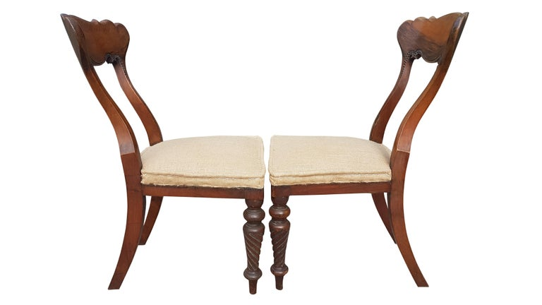 An elegant pair of Scottish bedroom chairs with spiral turned and carved front legs. The backs have a exaggerated sweep to them with a wide span carved back rail. They have been fully reupholstered in hessian retaining the original springs with a