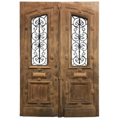 Pair of 19th Century Solid Oak Doors with Wrought Iron Inserts