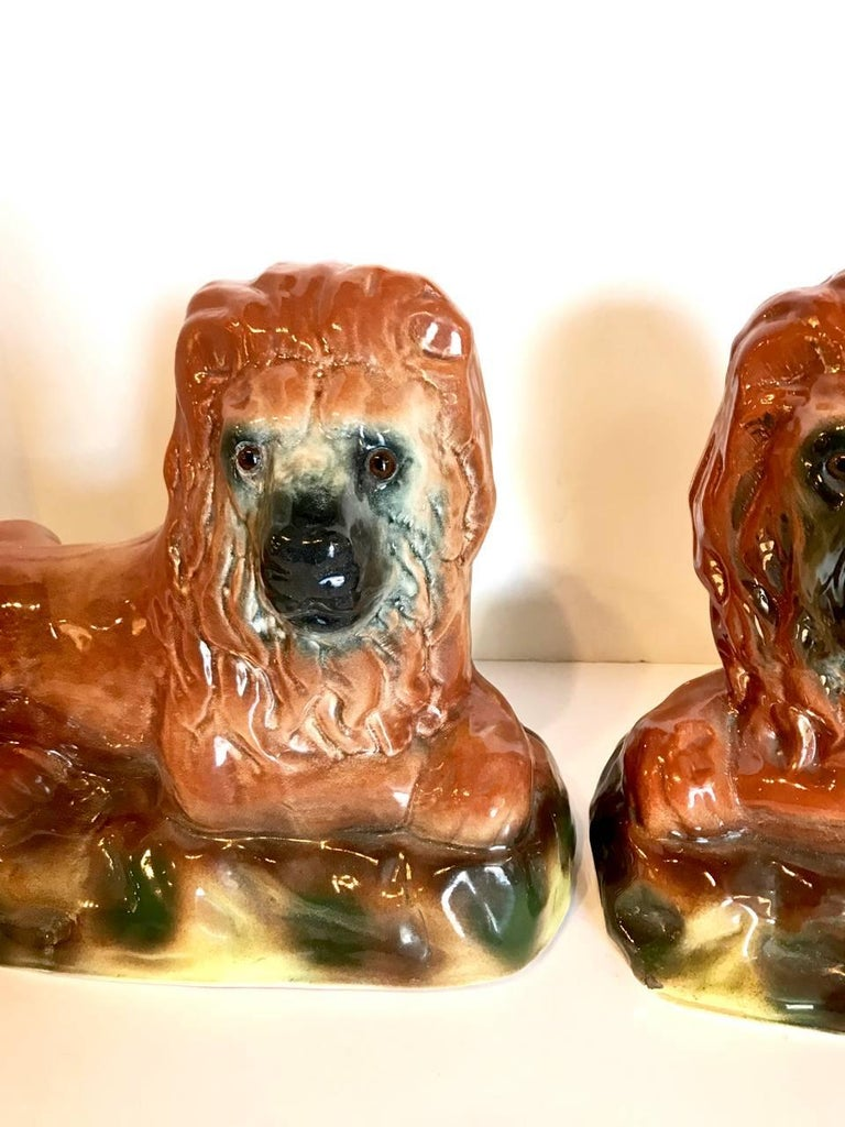 High Victorian Pair of 19th Century Staffordshire Recumbent Lions For Sale