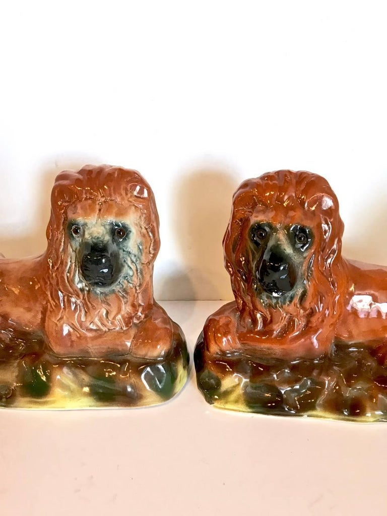 English Pair of 19th Century Staffordshire Recumbent Lions For Sale