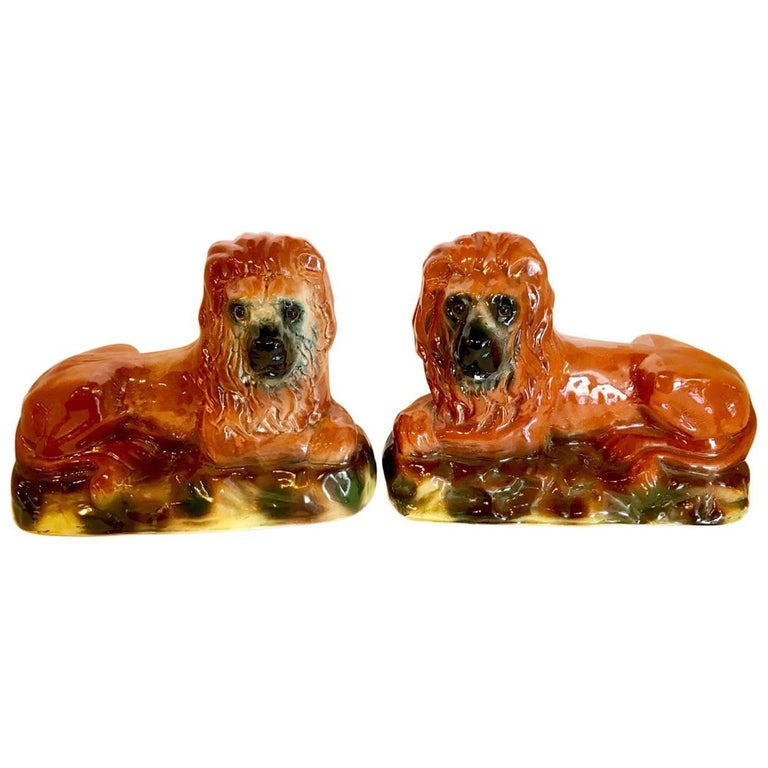Pair of 19th Century Staffordshire Recumbent Lions For Sale