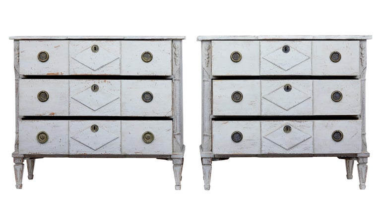 Fine pair of Swedish painted commodes, circa 1870.  Good quality pair of commodes, 19th century in later paint. 3 drawers with shaped drawer fronts. Canted corners with carved and applied detailing.  Faux marble hand painted top surface,