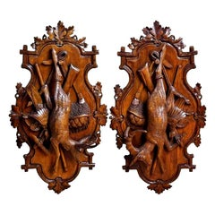 Pair of 19th Century Swiss Black Forest Carved Walnut Hunt Trophies Sculptures