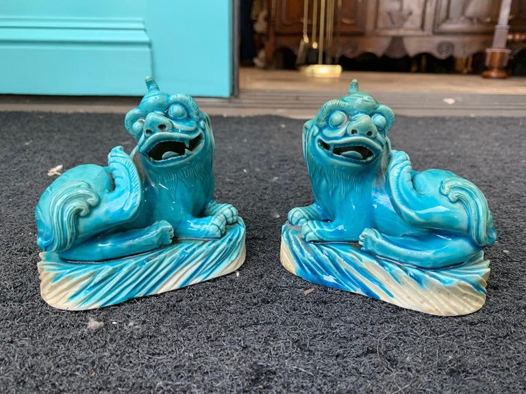 Pair of 19th century turquoise painted porcelain Foo dogs.