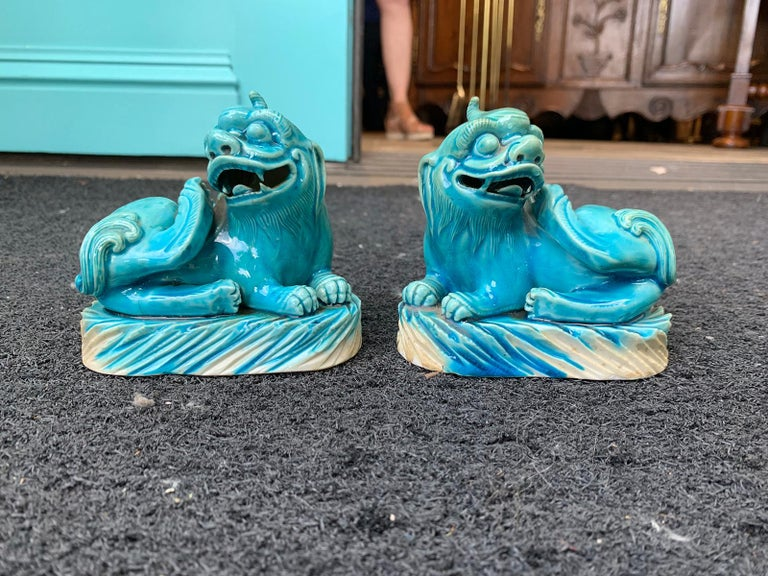 Glazed Pair of 19th Century Turquoise Painted Porcelain Foo Dogs For Sale