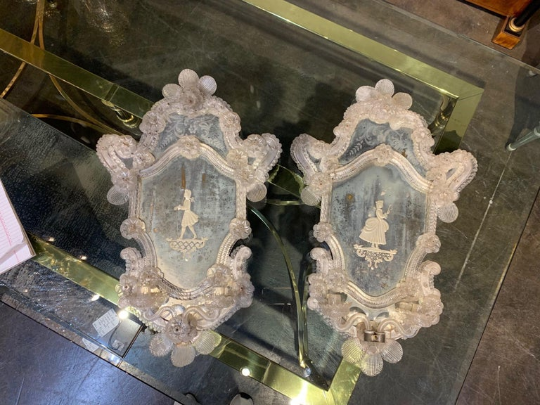 Beautiful pair of 19th century Venetian etched mirror sconces. Decorative flowers and etched images of fine ladies, possibly a mother and a daughter make this extra special!