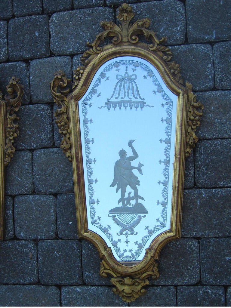 Pair of 19th century Venetian etched mirrors, Cartouche shape, with etched figure of man.