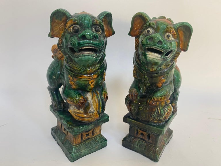 Chinoiserie Pair of 19th Chinese Tri-Colored Glazed Foo Lions /Dogs For Sale