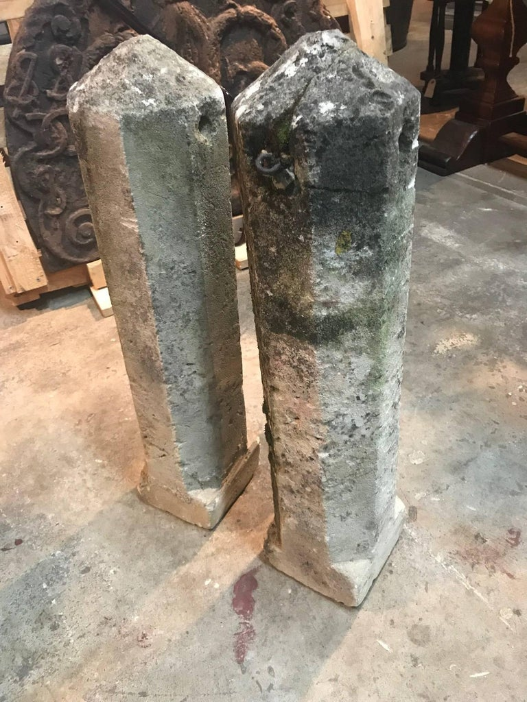 A handsome and primitive pair of carved stone markers of obelisk shape. Wonderful as garden ornaments or as an interior accent.