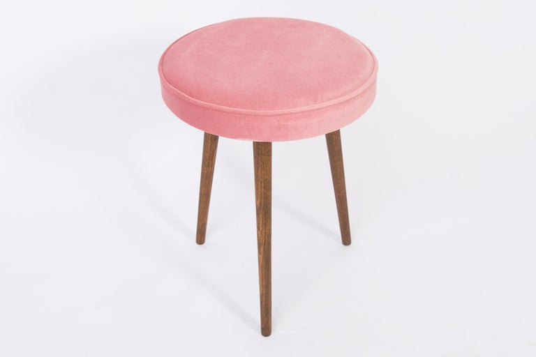 Stools from the turn of the 1960s and 1970s. Beautiful velvet baby pink upholstery. The stools consists of an upholstered part, a seat and wooden legs narrowing downwards, characteristic of the 1960s style. We can prepare this pair also in another