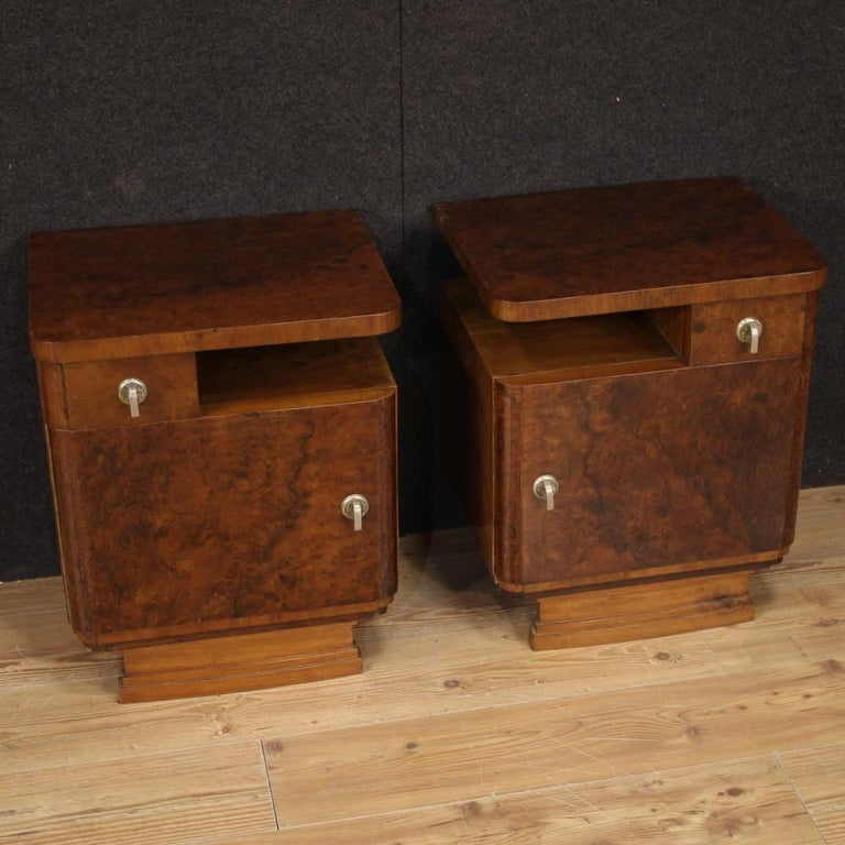 Pair of Italian bedside tables from the mid-20th century. Beautiful furniture in walnut and burl. Night stands equipped with a drawer, a side open compartment and a door, of good service. Door that offers a large compartment (see photo) of excellent