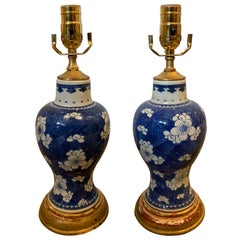 Pair of 20th Century Chinese Blue and White Porcelain Lamps on Custom Gilt Bases