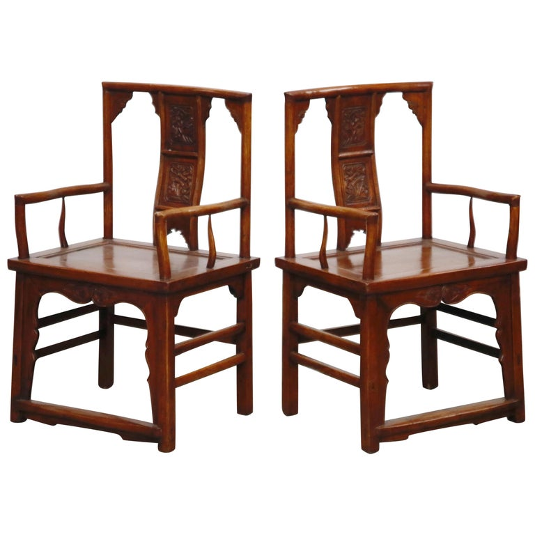 Pair of 20th Century Chinese Hardwood Carved Armchairs For Sale