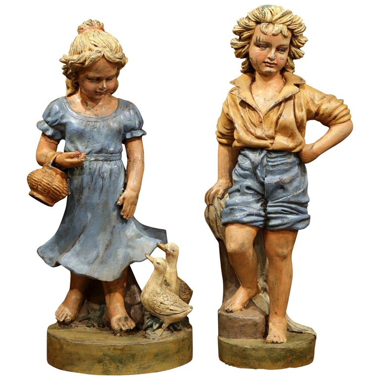 Pair of 20th Century French Hand Painted Boy and Girl Iron Sculptures For Sale