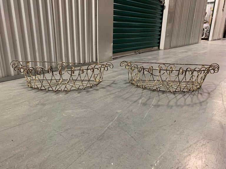 Pair of 20th century French iron wire planters.