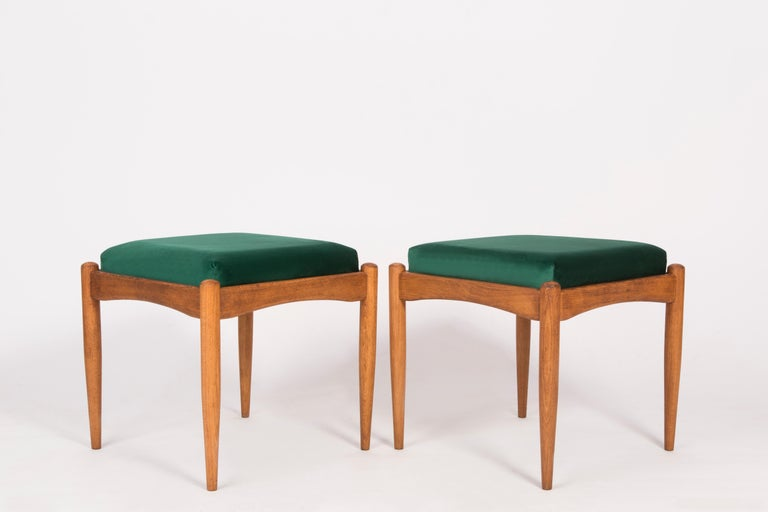 Stools from the turn of the 1960s and 1970s. Beautiful velvet green upholstery. The stools consists of an upholstered part, a seat and wooden legs narrowing downwards, characteristic of the 1960s style. We can prepare this pair also in another color