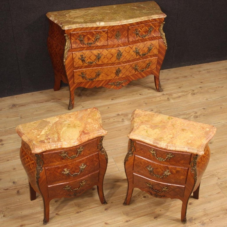 French bedside tables from 20th century. Moved and rounded furniture richly adorned with geometric inlay in wood of rosewood and walnut. Bedside tables decorated with finely gilded and chiseled bronze handles (see photo), equipped with three