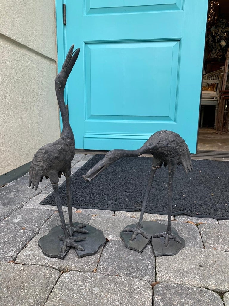 Pair of 20th century iron cranes on custom Lilypad bases, marked Japan