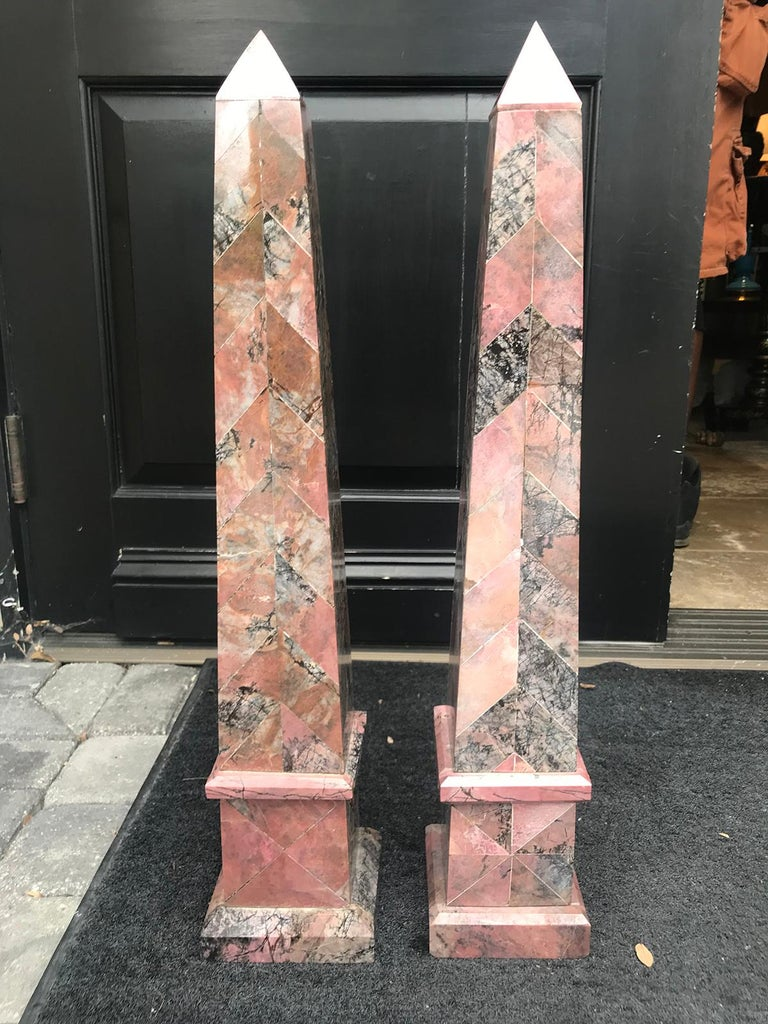 Pair of 20th century Italian large pink marble obelisks-one is slightly taller. One is 5.25