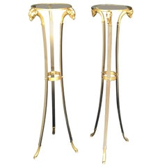 Pair of 20th Century Italian Neoclassical Steel & Brass Rams Head/Hoof Torcheres