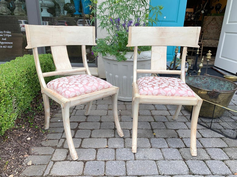 Pair of 20th century Klismos side chairs, in the style of T.H. Robsjohn-Gibbings.