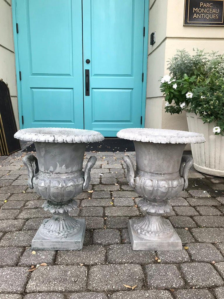Pair of 20th century large neoclassical metal urns Measures: 15.5